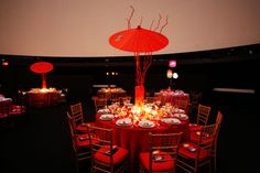Oversize paper umbrellas and twisted red branches decorated some tables. Photo: Eddie Quinones for BizBash Paper Umbrellas, Centerpieces, Table Decorations, Table Settings, Tailgating, Branches, Tabletop, Creative, Florals