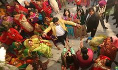"""""""The wedding celebration included four days of traditional rituals, eating and -- of course -- dancing."""" #India"""