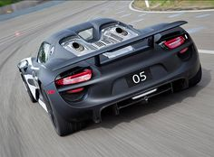 2014 Porsche 918 Spyder Hybrid - The prototype Porsche 918 plug-in hybrid is a rocket, boasting 770-horse power, a plastic monocoque body shell and crazy rear axle steering. This freakishly fast and futuristic machine is set to go on sale sometime in 2014, and will bear a price tag of nearly 1 million dollars.