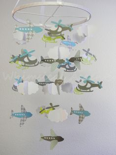 Trying to figure out how I could make something like this myself (maybe just with planes and clouds). Airplane, Helicopter and Cloud Baby Paper Mobile in Blue and Gray.  via Etsy.