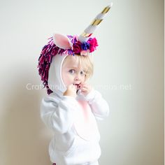 Super easy way to make a DIY Unicorn Costume for Halloween using white hoodie and leggings. Cutest unicorn costumes I've ever seen! The gold on the horn