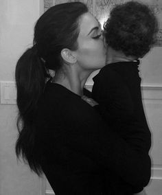 Too cute! Kim Kardashian shared an adorable picture of herself giving daughter North West, 12 months, a kiss goodnight. Hear what Kim K. has to say about being a mom!