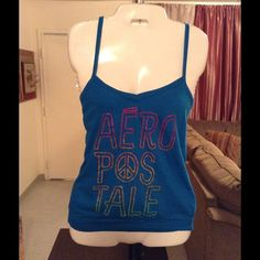 "AEROPOSTALE Top Aeropostale Top is made of 60% Cotton and 40% Polyester. Beautiful and rich bluish/Turquoise color. This top has Gold lettering that spell out Aeropostale. Size Medium. Length ""24. Laying flat ""14.5.  This item is in Good condition, Authentic and from a Smoke And Pet free home. All Offers through the offer button ONLY. I Will not negotiate Price in the comment section. Thank You Aeropostale Tops"