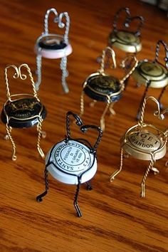 Leftover Champagne, corks, wire cages, bottles  all can be reused! This post links to various recipes using Champagne, and DIY projects for corks, cages, and bottles. [Pictured: hooded wire cages (a.k.a. muselets) from the tops of Champagne bottles made into mini-chairs  good for use as place card holders.]