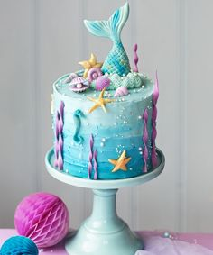 Celebrate that special someone in style with one of these beautiful birthday cakes! We've curated a collection of stunningly beautiful birthday cake decorating ideas to help inspire your baking passions and delight the guest of honor. #BirthdayCakes #CakesIdeas #BirthdayCakeIdeas #Birthday #Cake #Decorating #BirthdayCake #Baking #Food #Cooking #Desserts Ocean Birthday Cakes, Little Mermaid Birthday Cake, Ocean Cakes, Little Mermaid Cakes, Cute Birthday Cakes, Beautiful Birthday Cakes, Birthday Cakes For Girls, Rapunzel Birthday Cake, 7th Birthday