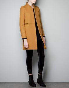 Straight cut woollen coat with mao collar and pleats on shoulders. Button closure with interior hook and eye fastening. Pockets within the seam at the waist. #zara