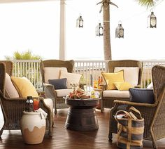 Beach house outdoor lounge area with wicker chairs