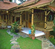 Bamboo house design with natural nuances. Staying in a bamboo house will bring you to the atmosphere of living in nature. House With Porch, House In The Woods, Filipino House, Bamboo House Design, Bamboo Building, Hut House, Philippine Houses, Bamboo Structure, Bamboo Construction