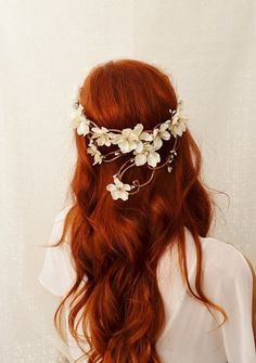white flowers & red hair.