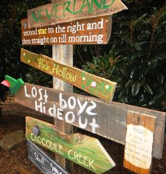 Customized Directional Sign Wooden Mile Marker Peter Pan Neverland for a Nursery/Kid's Room. $200.00, via Etsy.  Kates wedding