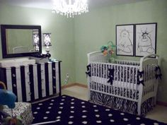 A neutral nursery decorated for boy and girl twins in sage green, black and white with a painted baby dresser, DIY artwork and custom baby crib bedding.