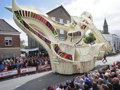 Another year, another Corso Zundert, the legendary parade of giant floats adored with thousands of dahlia flowers that twist through the narrow streets of Zundert, Netherlands. This year 19 teams took inspiration from the work of Vincent van Gogh who was born in Zundert 162 years ago. The towering floats borrow colors, motifs, and imagery from van Gogh's painting including several interpretations of the artist's self-portraits.