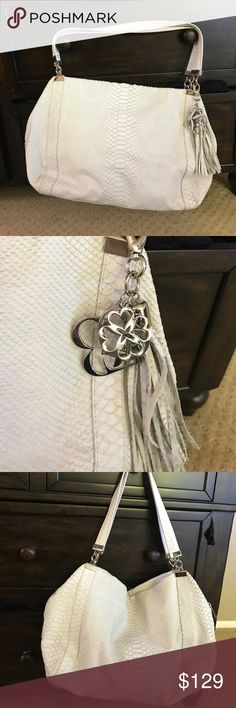 L.k. Bennett white Nicole bag w duster If you love large bags and this one is for you. This is the Nicole bag in white. Nice condition and the charm is wonderful. Includes duster. LK Bennett Bags Shoulder Bags