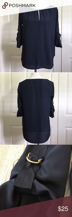 "Small Michael Kors Navy Blouse 100% Polyester. Light weight, rounded neck with key hole front. 20"" across, 25"" length in front and 27"" in back. Buckled sleeves. Perfect for dress or casual. Michael Kors Tops Blouses"