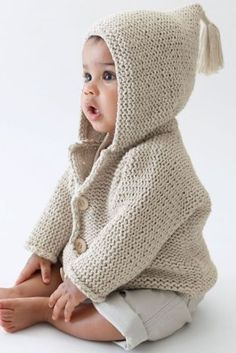 Fur trim knit jacket A pointed hood with soft fur trim, raglan sleeve and diamond-padded interior updates the knitted button-through cardigan. Works well as a mid to outerwear layer with a soft hand-feel crochet in soft pale shades.