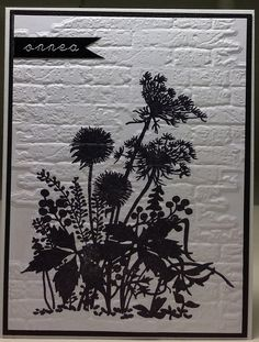card in black and white...rich texture from brick wall embossing folder and lovely sihouette image of wildflowers...