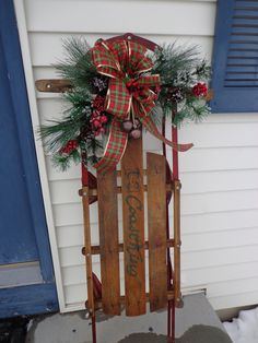 Our childhood sled that my sister had the foresight to save.  She was gracious enough to let me repurpose it for a very special Christmas decoration.