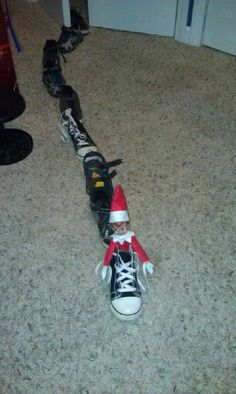 Elf on the Shelf idea - Elf makes a shoe shoe train - lol