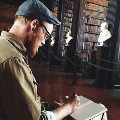 The red head sketching in the old library. What a hunk  #rookesonholiday