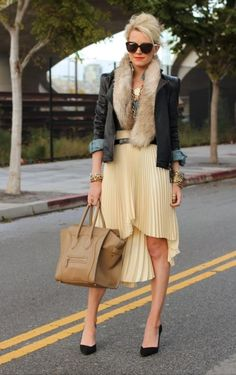 @Blair Eadie // Atlantic Pacific in black leather and a pleated high-low skirt