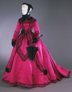 Woman's Dress: Bodice, Skirt, and Belt Probably made in United States, North and Central America c. 1866-68 Magenta silk satin with black silk satin and black cotton lace