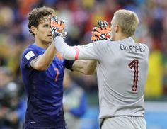 Netherlands' Daryl Janmaat, left, congratulates goalkeeper Jasper Cillessen following the team's 3-2 victory over Australia during the group...
