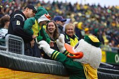 Jeff Blake and his son Wylie are greeted by puddles during the second quarter. (Mason Trinca/Emerald)