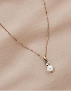 Bringing it back to the basics with a classic and timeless pendant necklace. Featuring a lustrous pearl and a mini set of crystals. We love how simple and elegant it is on it's own but we're not afraid to layer it with other dainty pendants. Gold Necklace, Pendant Necklace, Pendants, Pearls, Crystals, Elegant, Simple, Mini, Classic