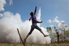 A young man's jumping up in the air as a sign of joy at the festival of rockets in Bung Bang Fai to celebrate the long-awaited rainy season. Yasothon, Thailand