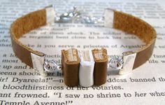 Miniature Book Bracelet The Stacks Stack of Three Mini Books Leather Bracelet by JanDaJewelry, $40.00