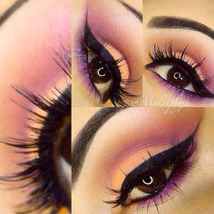 Piękno brzoskwiniowo-różowy makijaż w towarzystwie sztucznych rzęs.