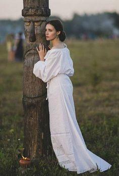 Slavic statue and girl