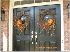 Double doors with double twig & pumpkin wreaths for fall - MadeinaDay.com