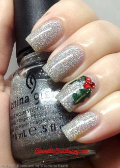 """By Lisa Marie Heath. I started this off with a base of China Glaze Glistening Snow, then 2 coats of Seche Vite to smooth it out.  After I used 3 nail gems for the """"berries"""" and used a toothpick to draw the mistletoe leaves  #holidaymani #glitter @Bloom.COM"""