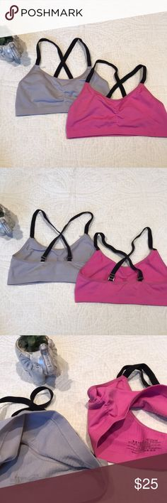 Girls Under Armor Sports Bra Bundle These are 2 adorable girls sports bras by Under Armor. They are both in EUC, but still have plenty of life left in them. The white one is more of a light grey and the pink one is true to color. Let me know if you have any questions!   Smoke free home Cat free home No off Poshmark transactions  All offers considered  Fast shipping Under Armour Shirts & Tops