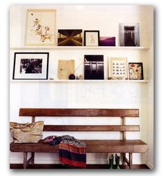 I love this casual style, complete with the natural/rustic wood bench, mod floating shelves and assorted arrangement of pictures and knickknacks.