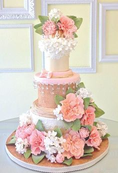 These drop-dead gorgeous wedding cakes fromLindsey Sinatra ofA Wish And A Whisk Cakes are sure to wow your wedding guests at the reception. I'm in love with the exquisitesugar flower and ruffle details of these cakes. Take a look! Click the image to enlarge and pin your favorite cakes.