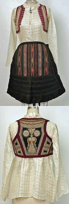 Woman's ensemble from Malissori (Malësia e Madhe, northern Albania), late 19th or early 20th century.  Medium: wool, cotton, metallic thread, ramie, animal skin, glass.  (Met Museum, N.Y.)