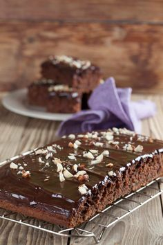 Moist Eggless Chocolate Cake Recipe - A moist and squidgy chocolate cake recipe made without eggs. Smother some chocolate ganache for that extra lusciousness. Sour Cream Chocolate Cake, Eggless Chocolate Cake, Chocolate Lovers, Chocolate Ganache, Cake Bars, Sweet Recipes, Cake Recipes, Dessert Recipes, Greek Desserts