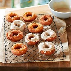 Old-Fashioned Potato Doughnuts with Coffee Glaze: Amy Thielen's nutmeggy Old-Fashioned Potato Doughnuts follow her grandmother's farmhouse recipe, but instead of powdered sugar, she tops them with vanilla-coffee icing. The recipe comes from Amy's book The New Midwestern Table (clarksonpotter.com). Recipe: http://www.midwestliving.com/recipe/old-fashioned-potato-doughnuts-with-coffee-glaze/