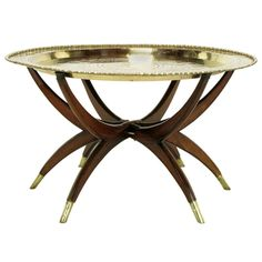 Moroccan Incised Brass & Mahogany Folding Six-Leg Tray Table | From a unique collection of antique and modern coffee and cocktail tables at https://www.1stdibs.com/furniture/tables/coffee-tables-cocktail-tables/  (=)