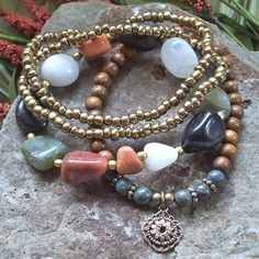 The name Beggar Bead comes from times past when people used to barter and these beads were traded in exchange for temporary shelter , a hot meal , or other necessities.     Gypsy Chic Beggar Bead, Wood and Russian Serpentine Stretch Bracelets by Angelof2, $26.00