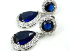 Swarovski Crystal Sapphire Blue teardrop earrings. Super elegant and sparky, white gold plated high quality components. believe me pictures does not make them justice! Perfect earrings for weddings and special occasions. These dazzling earrings made of cubic zircon stone and white plated settings.  Available in 4 amazing colors, please see the pictures.  More details: -earrings are 1 1/2 total length. -High quality Cubic Zirconia and white gold plated settings -stud ear wire in the top o...