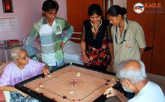 Elders playing carrom board
