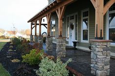 black stained front porch timber frame front porch | Add timber frame to existing stone pillars. Continue around on covered ...