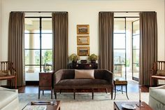 LIVING ROOM Landscapes by Lockwood de Forest are mounted behind the living room's circa-1800 Italian settee. Suzanne Rheinstein design ~ photo: Roger Davies