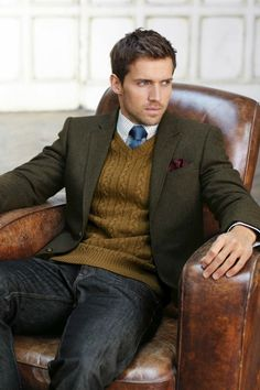 dark brown wool sport coat, brown cable knit v-neck sweater, blue tie, windowpane shirt, dark jeans