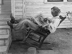 Farmer Reading Newspaper in Coryell County 1931 by  Unknown Artist