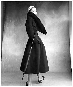 Lisa Fonssagrives wearing a coat by Christian Dior. Photo by Irving Penn for Vogue, 1950.
