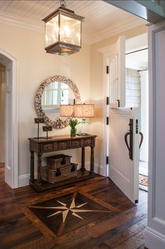 So much to love about this entry!  The floor, the lantern, the Dutch door!  #entryways #foyers  homechanneltv.com